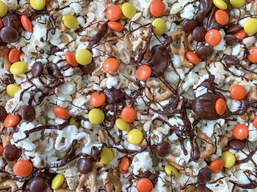 Chocolate covered popcorn with Reese's Pieces, peanuts and pretzels