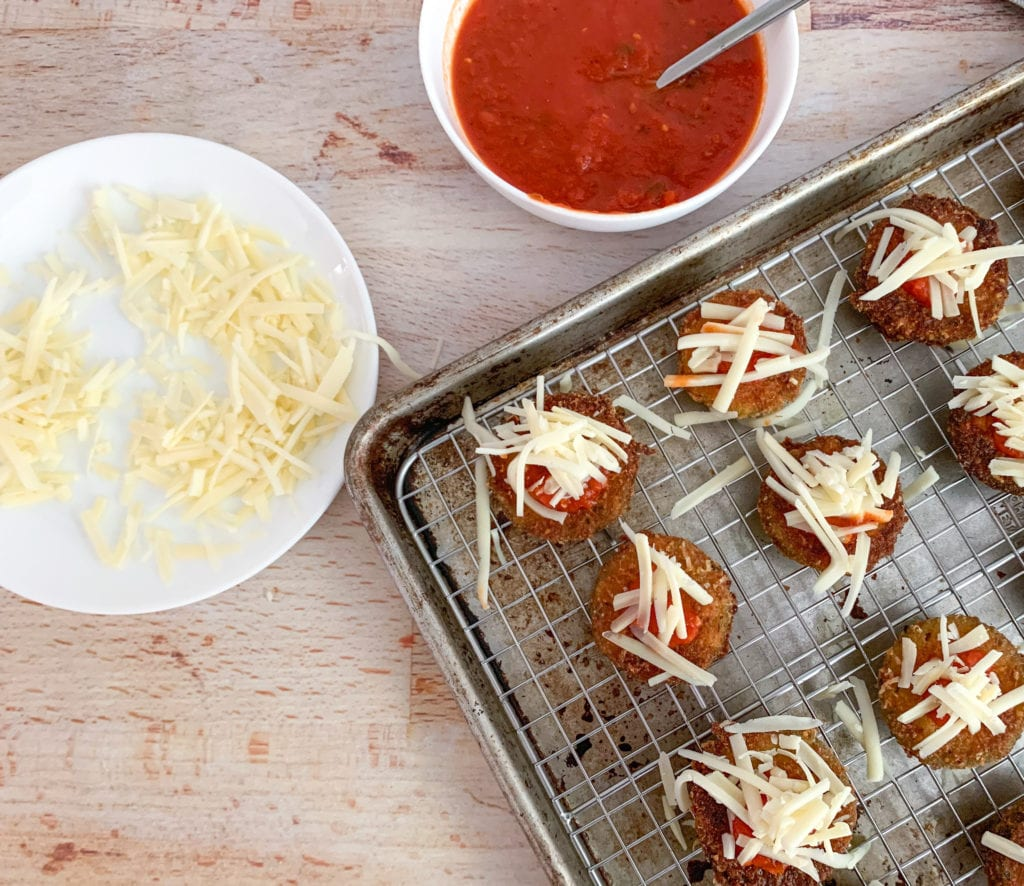 Zucchini Topped with tomato sauce and cheese