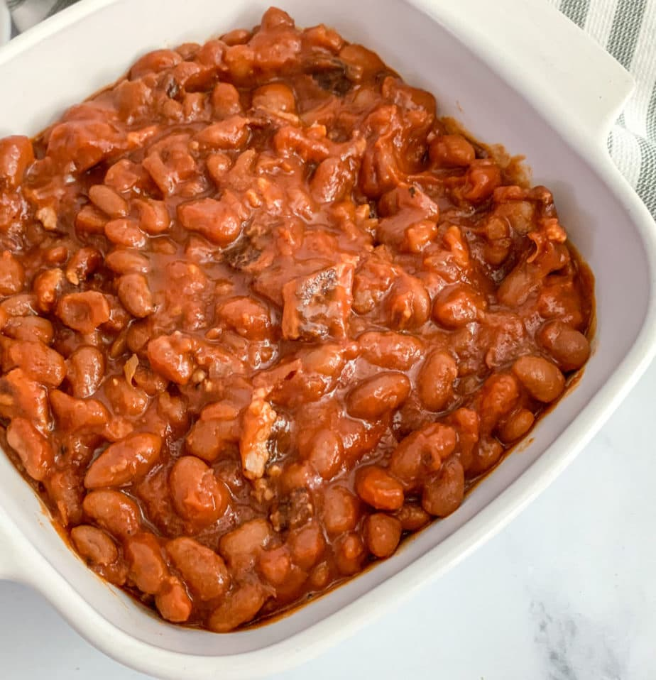 A baking dish full of homemade baked beans