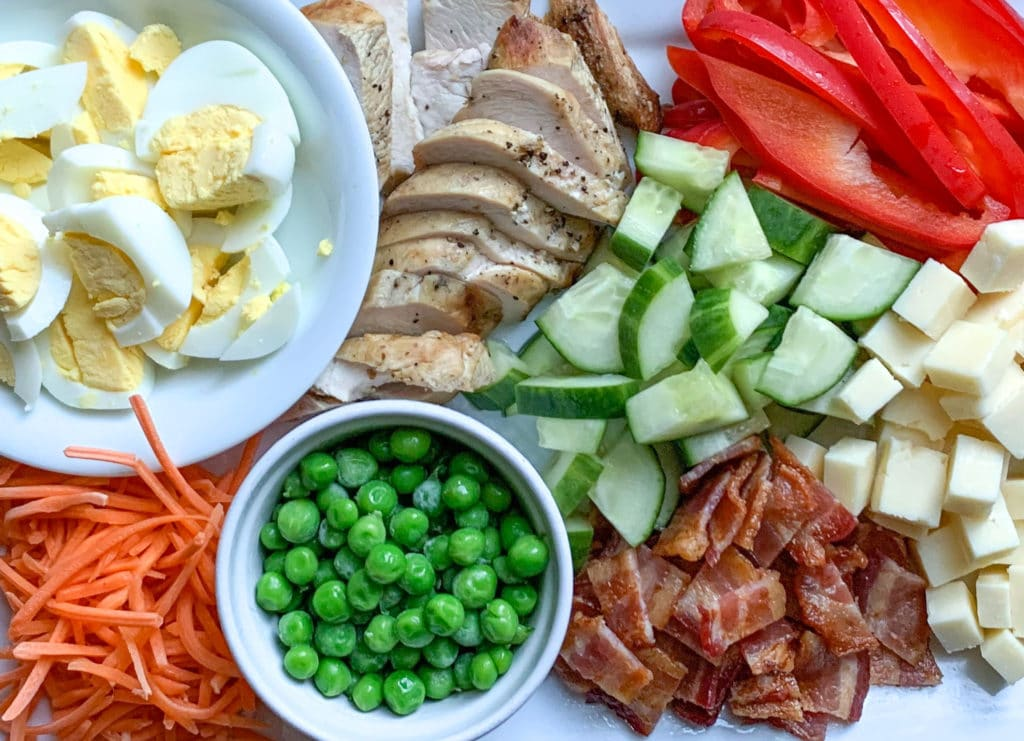 Ingredients to make a cobb salad with chicken