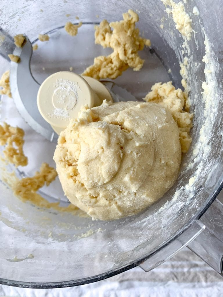 How to make Glazed Vanilla Bean Scones- Pulse the wet ingredients into the dry until a ball forms around the blade of the food processor