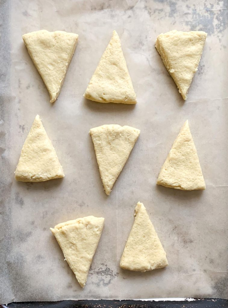 How to make Glazed Vanilla Bean Scones- Line the a parchment lined cookie sheet with scones.