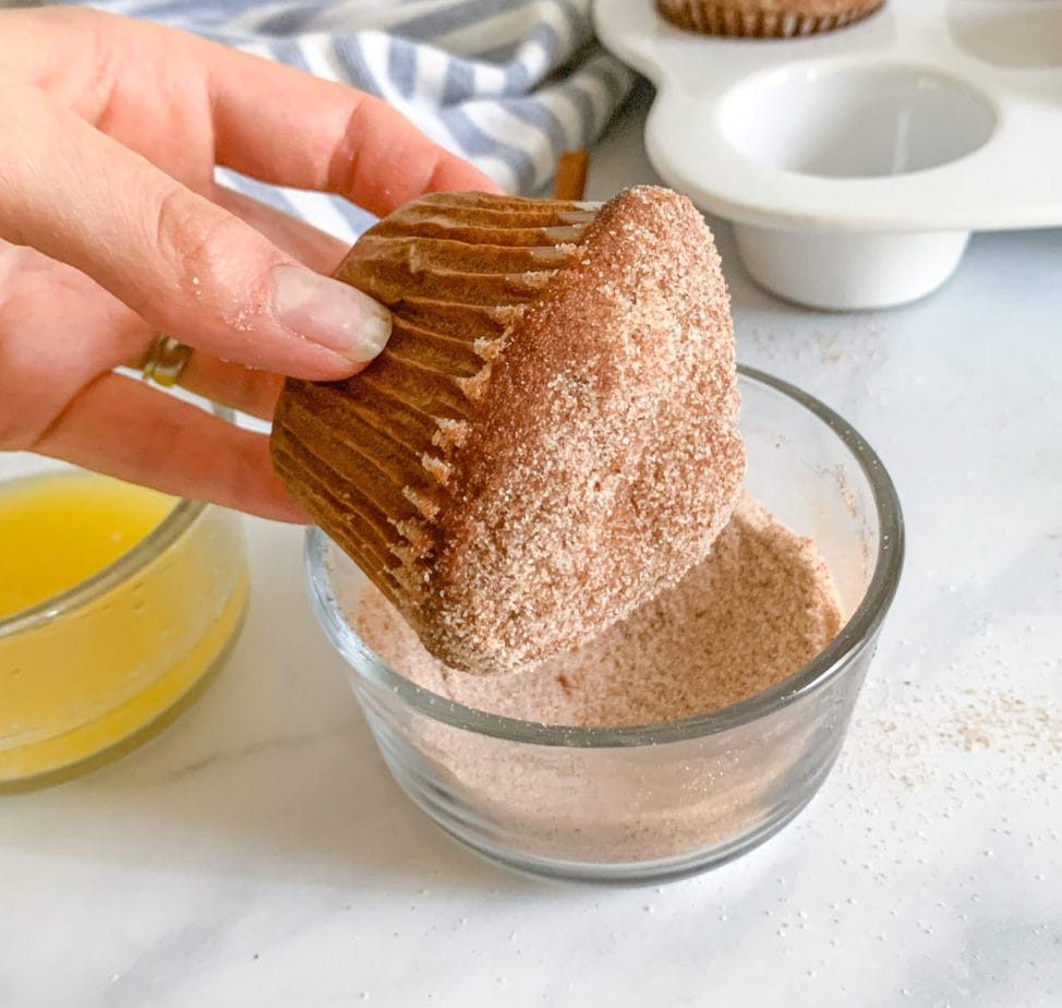 After dipping in butter, roll muffins in cinnamon sugar