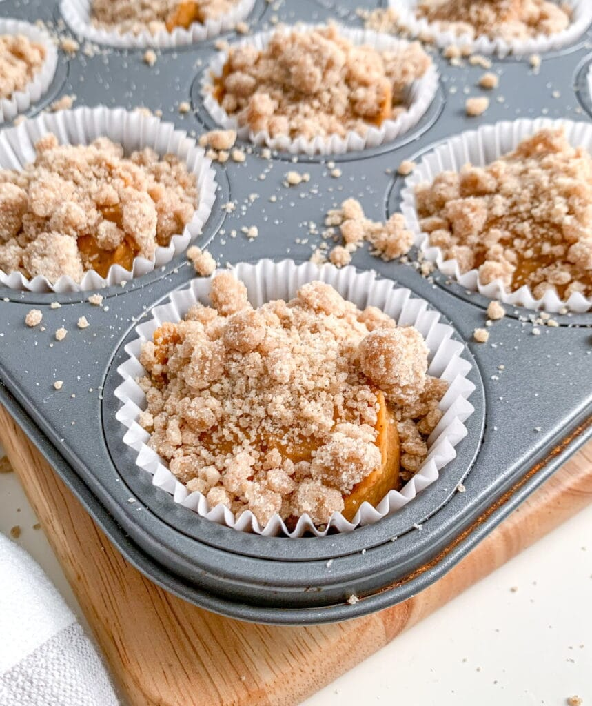 Moist pumpkin muffins topped with a crunchy streusel crumb
