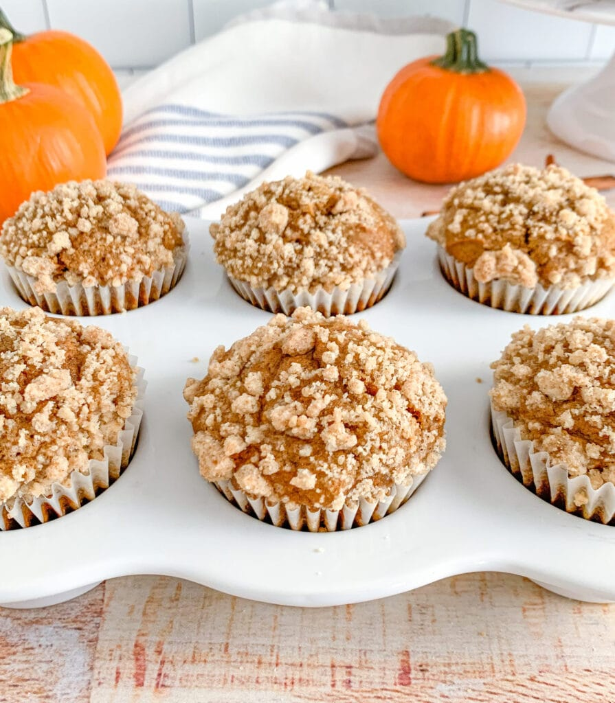 Moist pumpkin spice muffins topped with a sweet crumb streusel