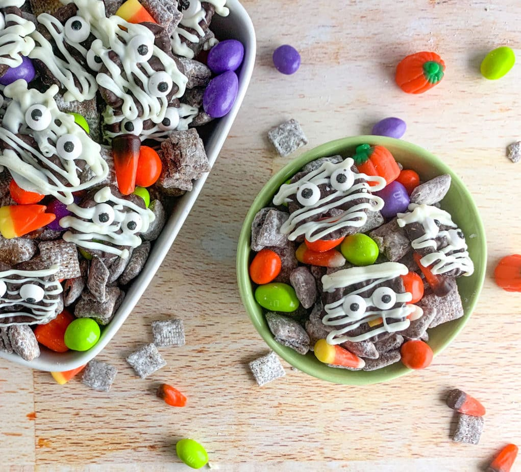This Halloween Snack Mix is full of chocolate covered Chex cereal, ghoul colored Peanut M&M's, candy corn and candy pumpkins and DIY chocolate covered Mummies!