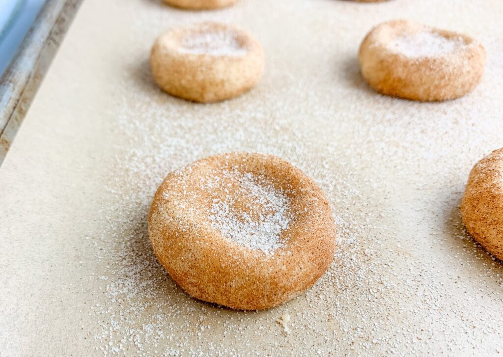 Sprinkle a little more cinnamon sugar on top of the flattened snickerdoodle