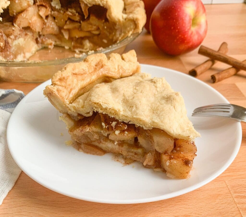 A slice of apple pie, full of from scratch apple pie filling