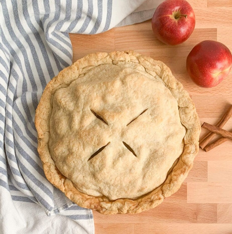Mom's apple pie recipe from scratch. Fresh apples tossed with cinnamon sugar and baked in a flaky, buttery crust