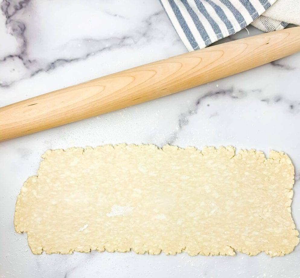 "Roll out the pie crust so that it's about twice as long as it is tall, and 1/4"" thick"