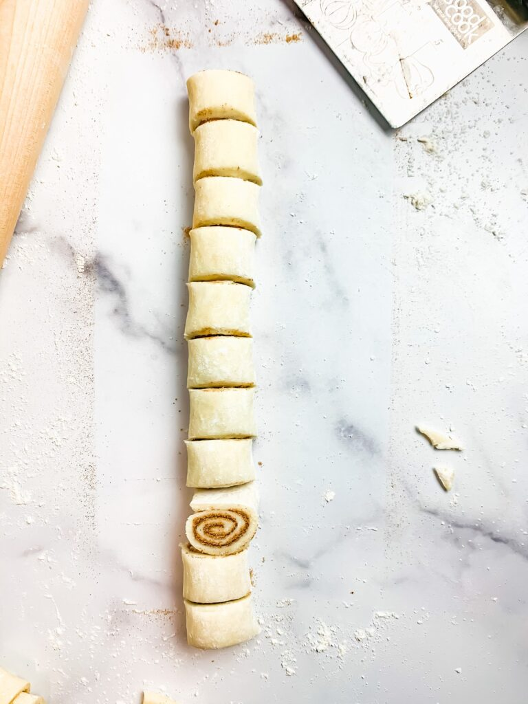 Slicing Cinnamon Pinwheels for the to be baked