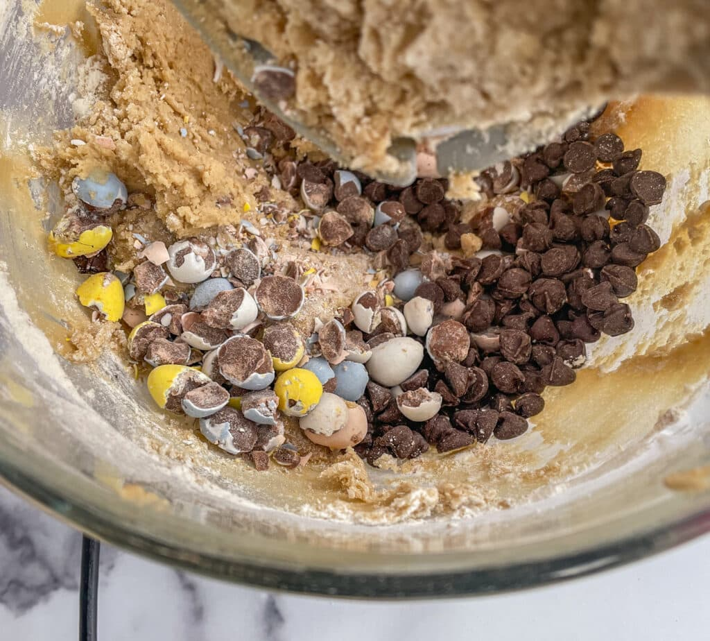 Add the mini eggs and chocolate chips to the cookie dough batter