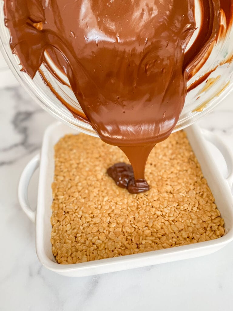 Melt chocolate chips and peanut butter together in the microwave and pour over you pan of Rice Krispies Treats