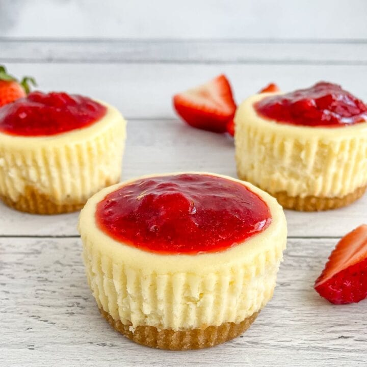 Mini Vanilla Cheesecake Cups Topped with Strawberry Sauce