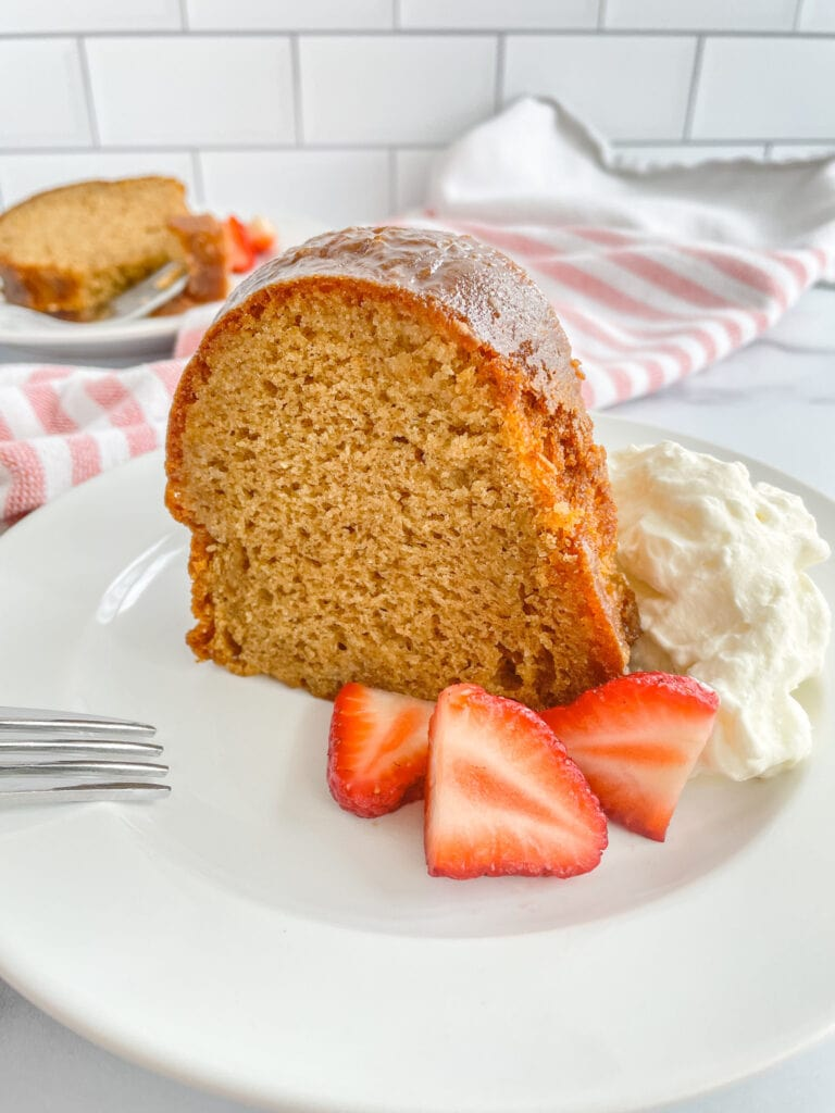 A slice of Crack Cake with strawberries