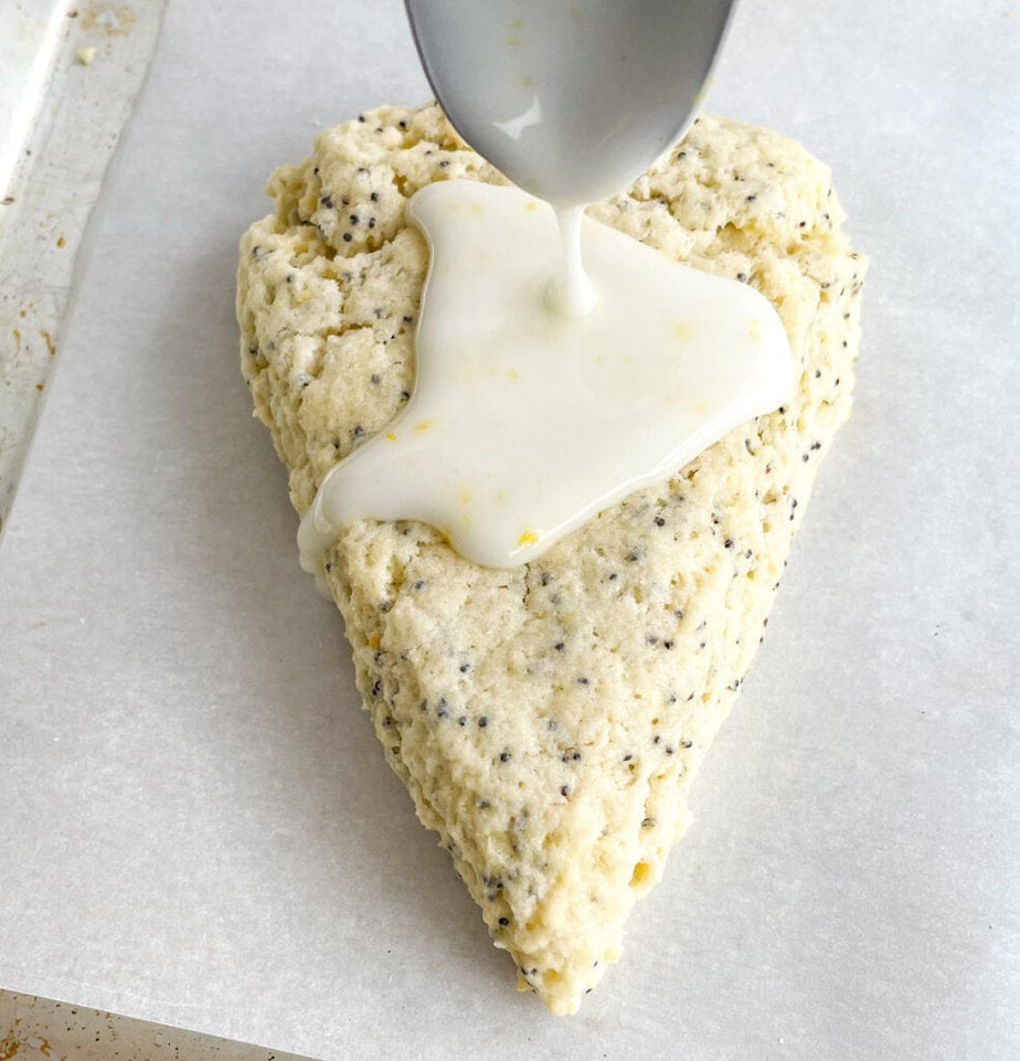 Drizzle the lemon glaze over the lemon poppy seed scones