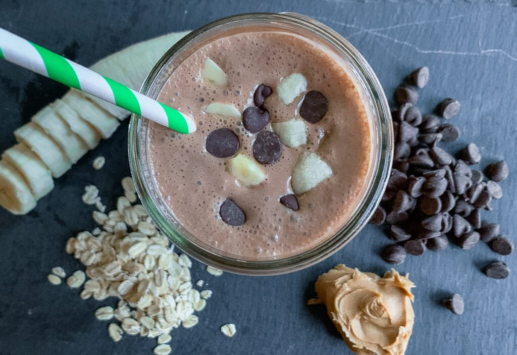 Healthy chocolate smoothie with peanut butter, banana, and oats