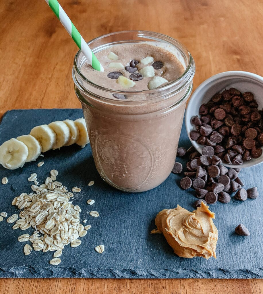 A healthy smoothie made with peanut butter, cocoa, oats, sweetened with bananas and maple syrup.