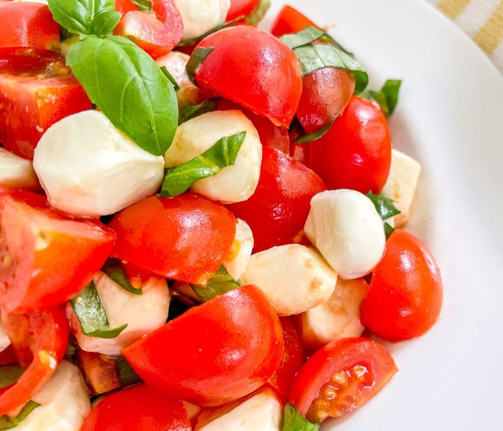 Mozzarella pearls, cherry tomatoes, fresh basil, and balsamic vinaigrette