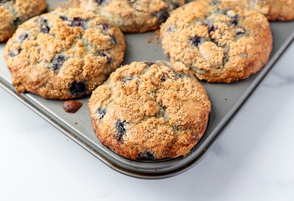 Blueberry muffins out of the oven with maple sugar on top