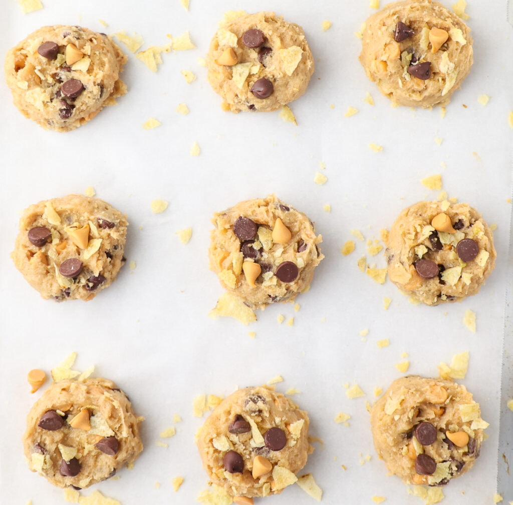 Use two fingers to make an indentation in the center of the cookies. This will help them to bake evenly.