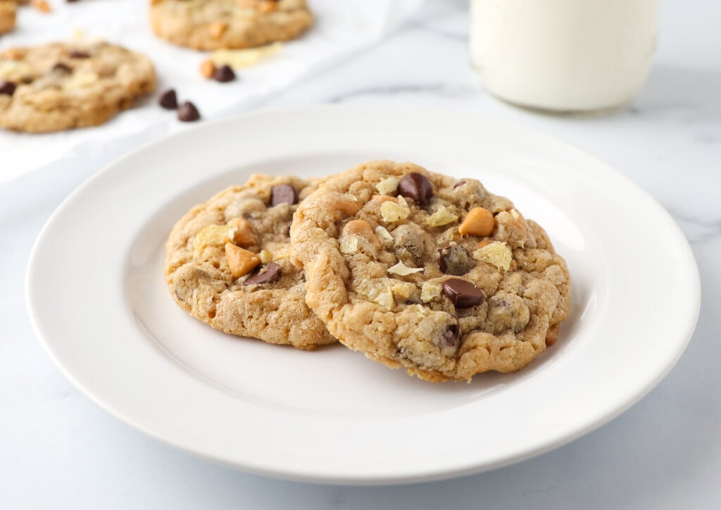 Plated Butterscotch Chocolate Chip Cookies with a glass of milk.