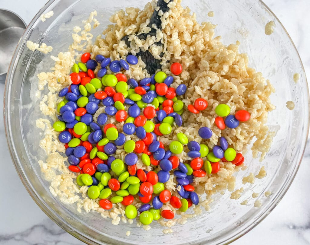 Add the M&Ms to the Rice Krispie Mixture at the last minute
